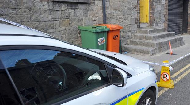 Gardai tape off a townhouse in Drogheda, County Louth, Ireland in connection with a body found on Mornington Beach.