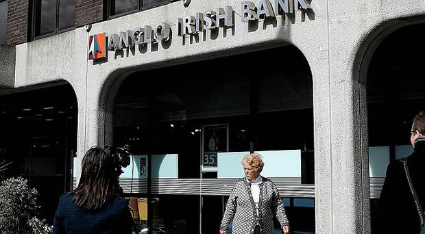 Three former bankers have been charged with conspiracy to defraud linked to seven billion euro of deposit transfers allegedly made to prop up Anglo Irish Bank's books.