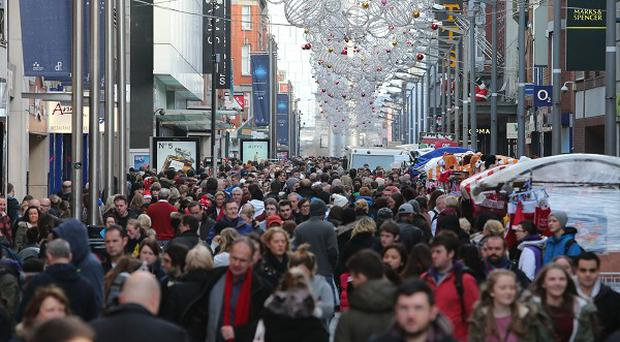 Christmas shoppers on Dublin's Henry Street (PA)