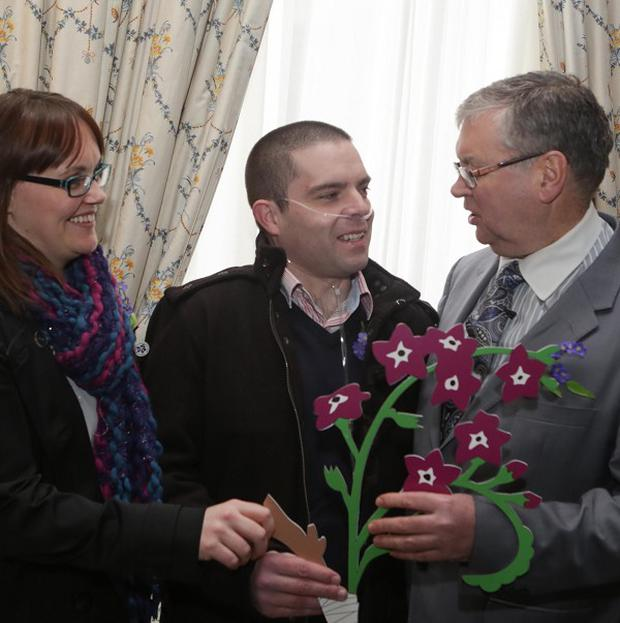 Stephen Smith, centre, with his wife Rachel and RTE presenter Jow Duffy, ambassador of Organ Donor Awareness Week, before his transplant operation