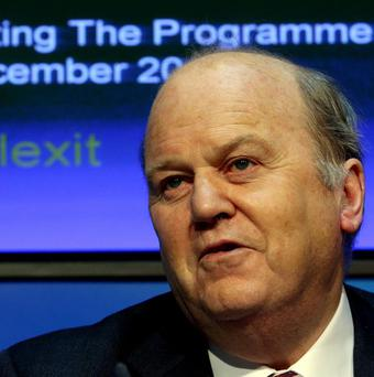 Finance Minister Michael Noonan has hailed big demand in international markets as Ireland held its first sovereign debt auction since the bailout ended