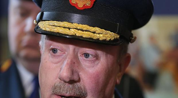 Garda commissioner Martin Callinan wants a line drawn under allegations of spying operations.