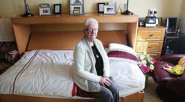 Patricia O'Brien in her bedsit on Ballygall Road, before she attends a sod turning ceremony at the unveiling of a new social housing project in Ballygall Road East, Glasnevin, Dublin