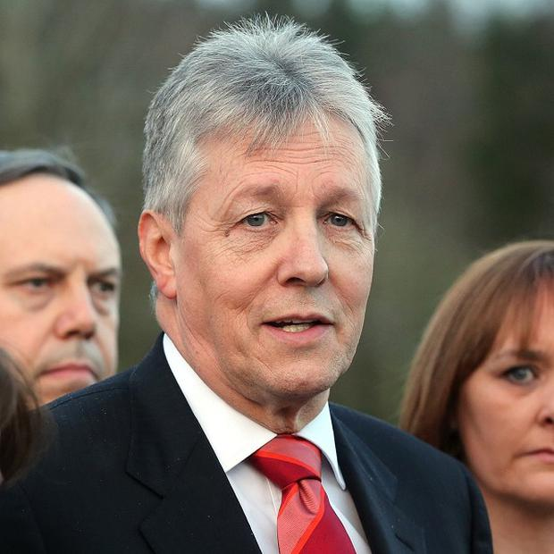 Northern Ireland's First Minister Peter Robinson, centre, had threatened to resign over the controversy about on-the-run republicans