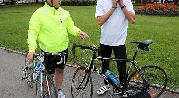Breifne Earley pictured training with Irish Olympian Mark Kenneally (World Cycle Race/PA)