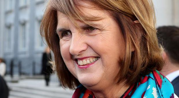 Joan Burton called for employers to take on apprentices to get people back into work