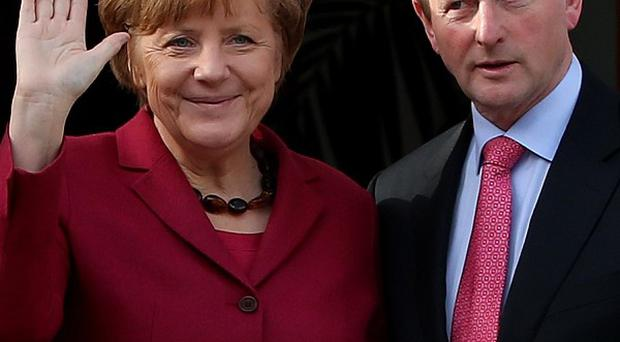 German Chancellor Angela Merkel and Taoiseach Enda Kenny arrive for a press conference at Government Buildings in Dublin