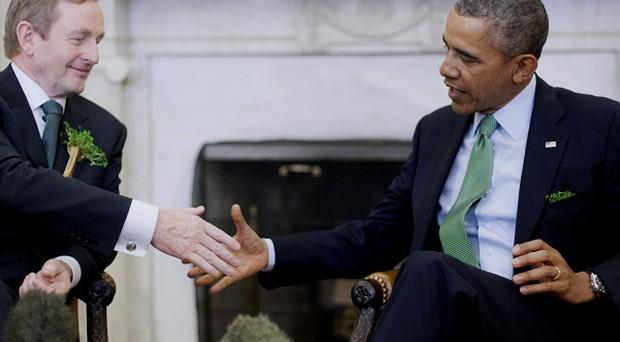 President Barack Obama shakes hands with Irish PM Enda Kenny in the Oval Office (AP)
