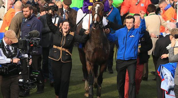 Davy Russell onboard Lord Windermere celebrates winning the Gold Cup