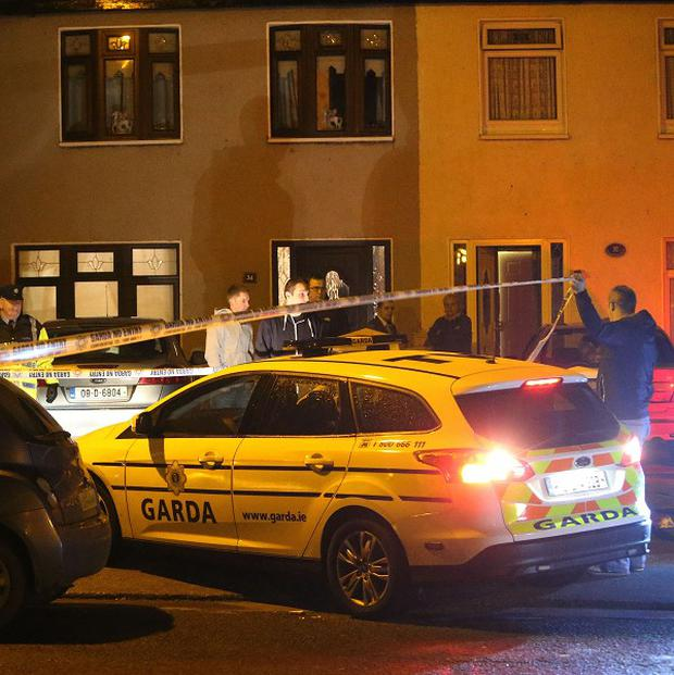 Garda outside the house in Greenfort Crescent, Clondalkin where drug lord John Gilligan, chief suspect in the murder of Veronica Guerin, was shot.