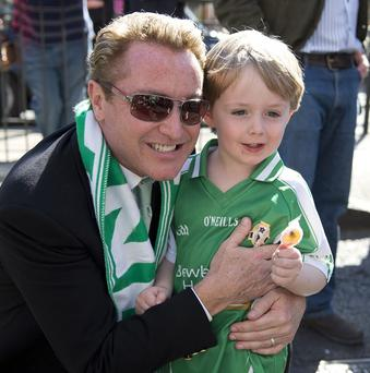 Michael Flatley with a young fan at the start of the Mayor of London's St Patrick's Day parade in central London.