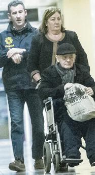 John Gilligan leaves hospital in Dublin accompanied by gardai