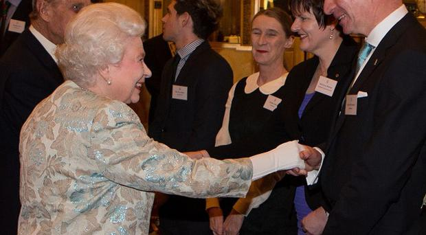 Queen Elizabeth meets Pat O'Connell at a reception for the Irish community at Buckingham Palace in London