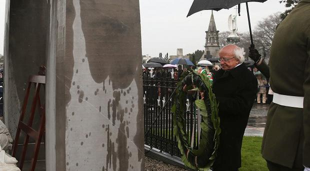 President Michael D Higgins lays a wreath at the Sigerson Memorial in Glasnevin Cemetery