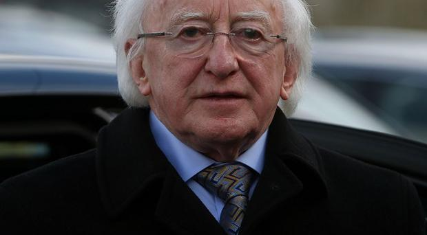 Michael D Higgins said progress in the Northern Ireland peace process should not be about forgetting the past.