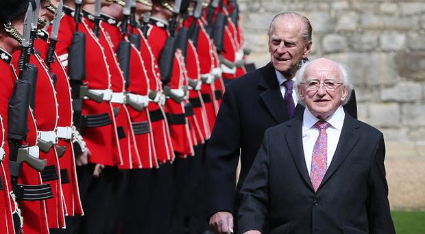Michael D Higgins inspects a Guard of Honour with Britain's Duke of Edinburgh at Windsor Castle in Berkshire