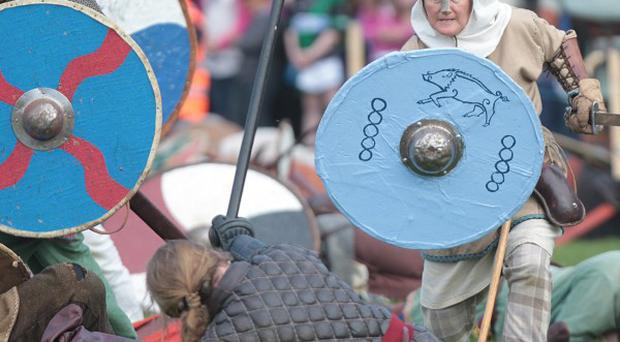 People dressed as Vikings take part in a re-enactment of the Battle of Clontarf hosted by Dublin City Council at St Anne's Park in Raheny
