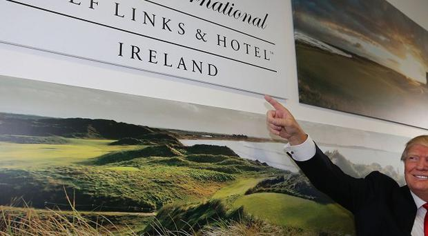 US tycoon Donald Trump arrives at Shannon Airport to visit the Doonbeg course after he got the go-ahead from council chiefs to shore up the famous 14th green on the course