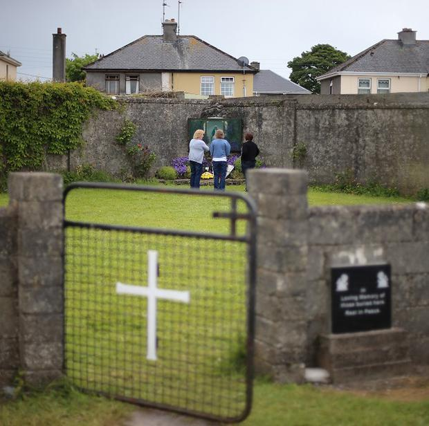 Members of the public at the mass grave in Tuam