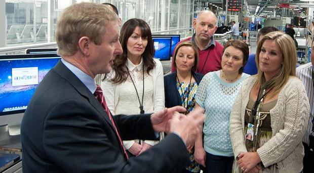 Taoiseach Enda Kenny visiting Apple employees in Cork.