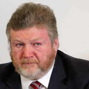 Health Minister Dr James Reilly apologised after some patients were withdrawn from the free healthcare system