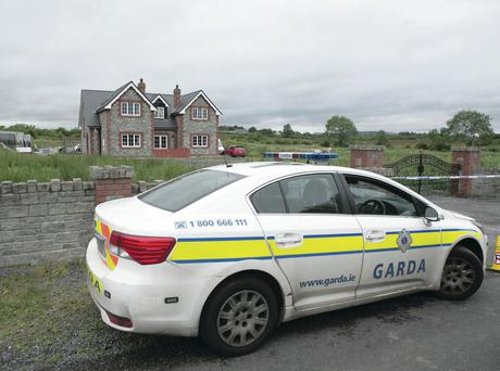 A Gardai car sits outside the house in Turlestrand, Co Sligo, where brothers Brandon and Shane Skeffington died
