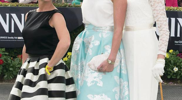 Helen Murphy (centre), winner of the best dressed lady competition at the Galway racing festival, with Paula Clancy (left), winner of the best hat, and Emer Nash, winner of the Wear Irish prize