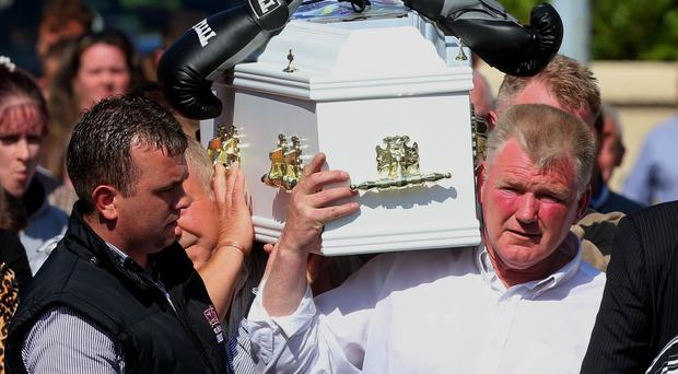 The funeral of twin boys Thomas and Patrick O'Driscoll, who died in a suspected murder-suicide with their older sibling Jonathan, takes place at the Holy Cross Parish Church in Charleville