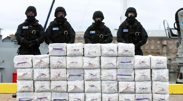 Members of the navy stand behind cocaine which was taken from onboard the yacht Makayabella in Co Cork