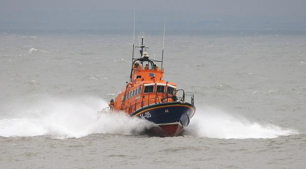 The Dun Laoghaire RNLI lifeboat has helped rescue a sailor who suffered suspected spinal injuries