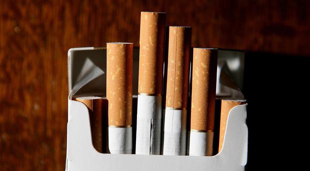 A Ballymoney bus driver who allowed smugglers to hide over 100,000 contraband cigarettes in a trailer at his premises was freed when his nine-month jail term was suspended for two years