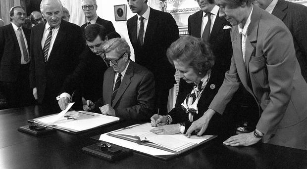 Garret FitzGerald and Margaret Thatcher signed the Anglo-Irish Ulster Agreement at Hillsborough Castle, Belfast in 1985