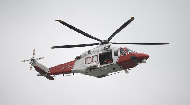 A rescue helicopter was sent to the scene off the Isle of Lewis to assist the crew of the boat