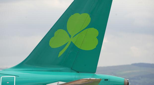 Aer Lingus is considering a sweetened takeover offer from the owner of British Airways