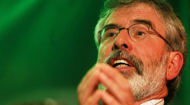 Gerry Adams said Sinn Fein would introduce a third rate of income tax for the rich if it can form part of the Irish government