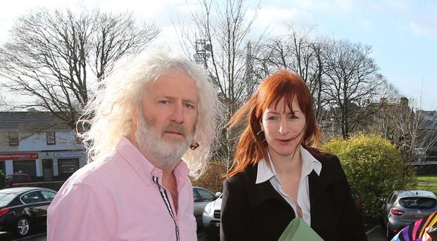 Mick Wallace and Clare Daly arrive for an earlier hearing at Ennis District Court
