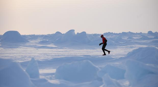 The Arctic scenery makes a spectacular backdrop for runners (npmarathon.com/PA)