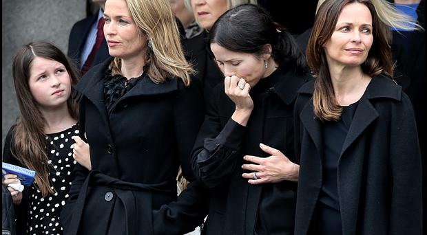 Family anguish: Caroline, Andrea and Sharon Corr attend the funeral of their father Gerry Corr at the Church of the Holy Redeemer in Dundalk