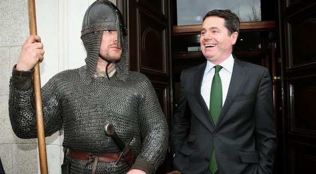 Minister for Tourism, Transport and Sport Pascal Donohoe is greeted by Dave Swift during the launch of Ireland's Ancient East tour at the RDS in Dublin