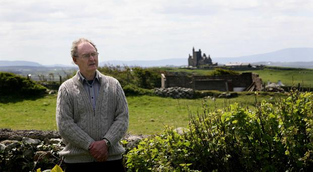 Local historian Joe McGowan in his garden in front of Classiebawn Castle, the home of Lord Mountbatten in Mullaghmore