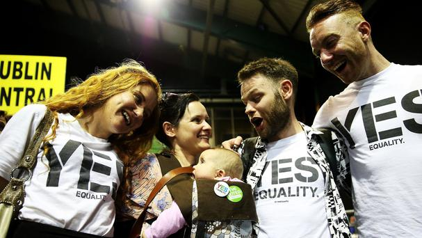 Yes voter Deirdre Duffy and her seven-month-old daughter Belle with Yes campaigners Kristina Vaughan, Mark Dempsey and Ger O'Keeffe