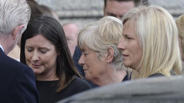 The widow of the late sports broadcaster Bill O'Herlihy, Hillary O'Herlihy, centre, and their daughters Sally, left, and Jill, attend his funeral mass in Dublin