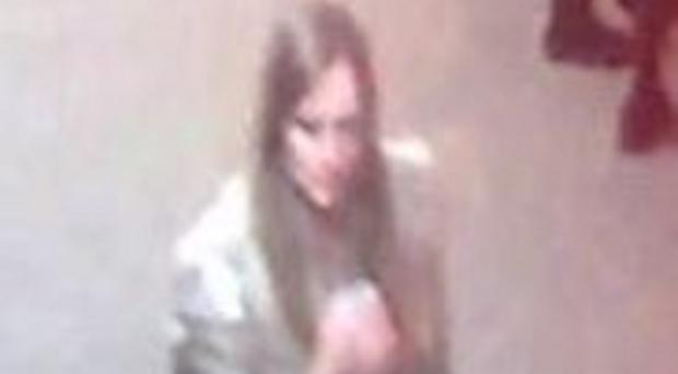 Detectives investigating the death of Irish student Karen Buckley wish to speak to the woman captured in this CCTV image (PA/Police Scotland)