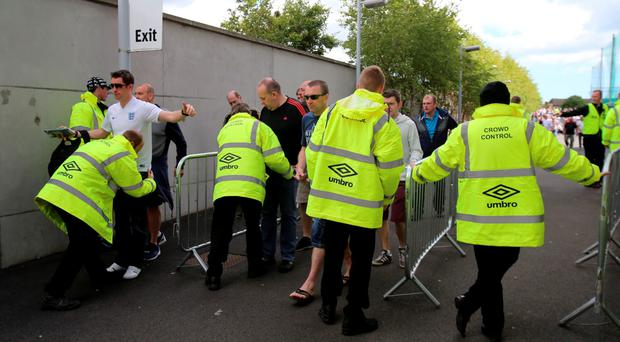 England fans are searched as they enter the ground