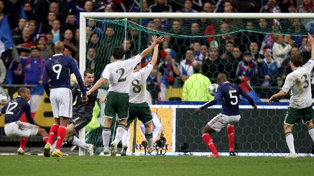 Irish players appeal in vain for handball against Thierry Henry as William Gallas scores