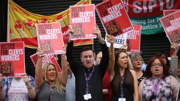 Supporters and former members of staff at Clerys stage a protest demanding answers after the historic store closed its doors on Friday
