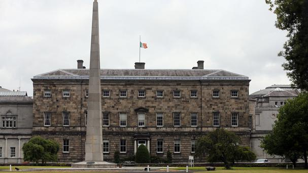 A flag flies at half mast at Leinster House