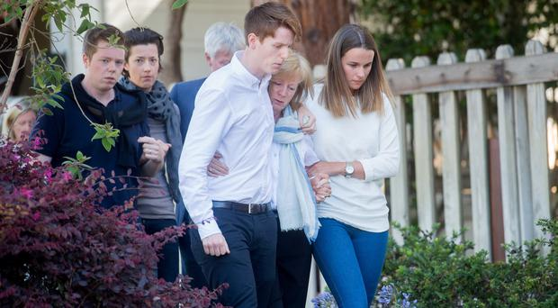 Mourners arrive at a vigil for four Irish students who died when a Berkeley apartment balcony collapsed (AP)