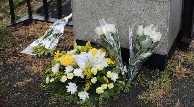 Flowers at St Marys College in Rathmines, Dublin, where UCD students Niccolai Schuster and Eoghan Culligan studied before they were killed in a balcony collapse in the US.