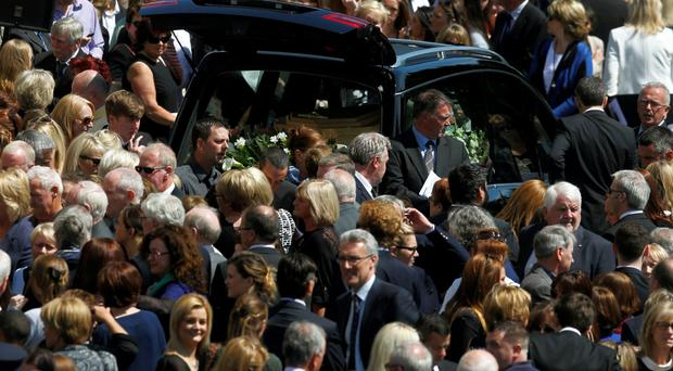 Crowds of mourners gather at the funeral mass of Eimear Walsh, in Our Lady of Perpetual Succour in Foxrock, Dublin